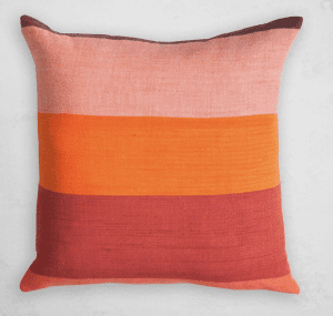 Choosing throw pillows to refresh a boring sofa can be overwhelming. But have fun with them! Add color, texture, graphics or prints, & pile the pillows on for an instant refresh.