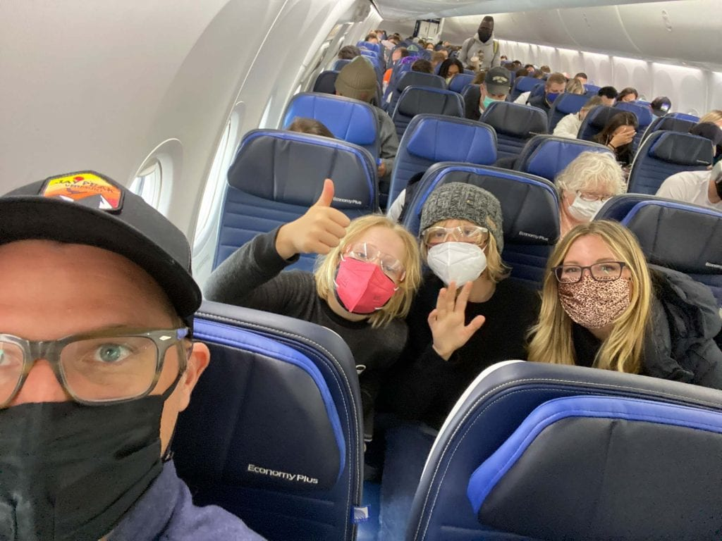 Traveling w/ kids during the pandemic? Risky, but we did it. Our tips, lessons & packing essentials for flying (airport, plane + rental car) that made it (feel) a bit safer.