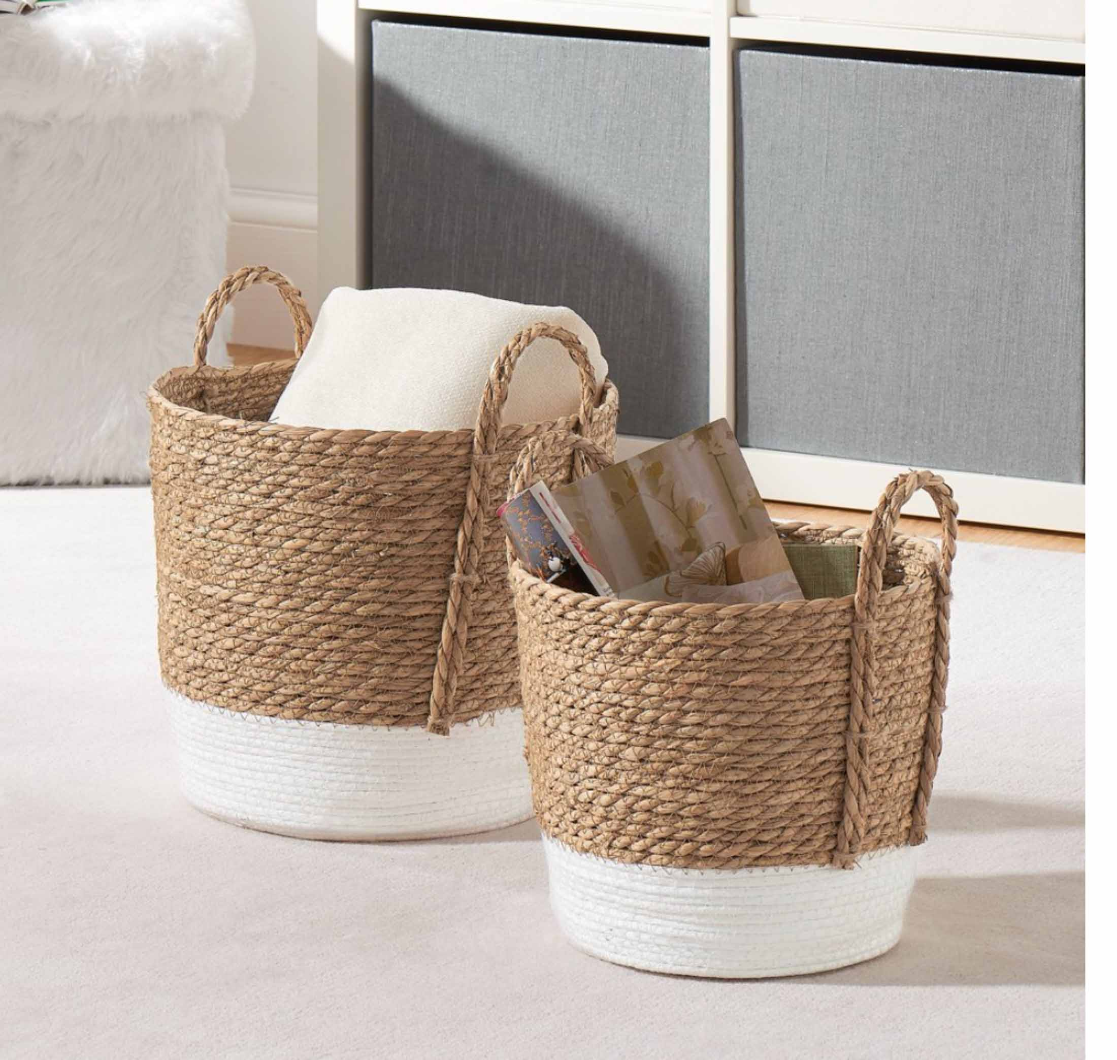 For summer, I love swapping out throw pillows, artwork & bright tableware...bringing in that beachy boho feel or nautical theme by adding greenery + textured baskets.