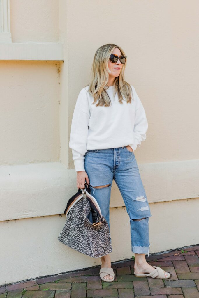 Sweatshirts are not sweater replacements, but they're a heck of a lot better than most long-sleeve t-shirts. Sweatshirts are just tops, with a sporty, nonchalant vibe.