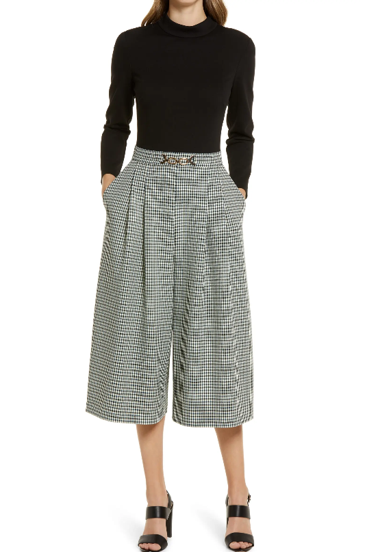 The Eliza J Twoffer Wide Leg Jumpsuit is so freaking chic I can't stand it. I love the details, the checkered cropped pants, basically everything about it.