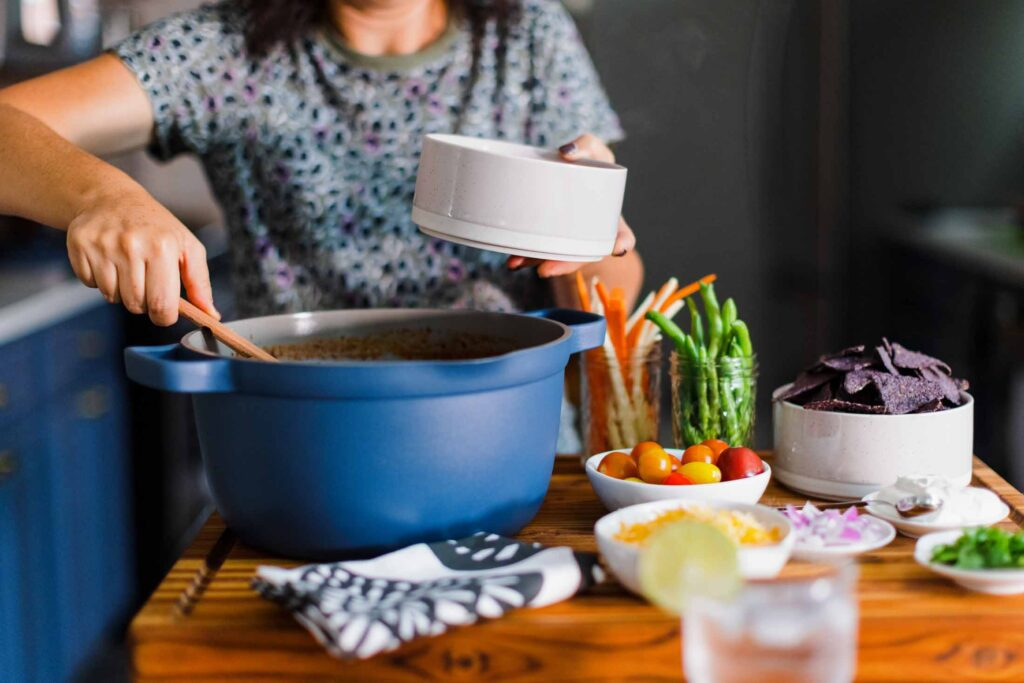 One single pot that can do ALL the things: boil pasta (& drain it w/ the built-in strainer), slow cook chili, roast crispy chicken, steam idlis (Indian dumplings), + pan-fry & bake things too?